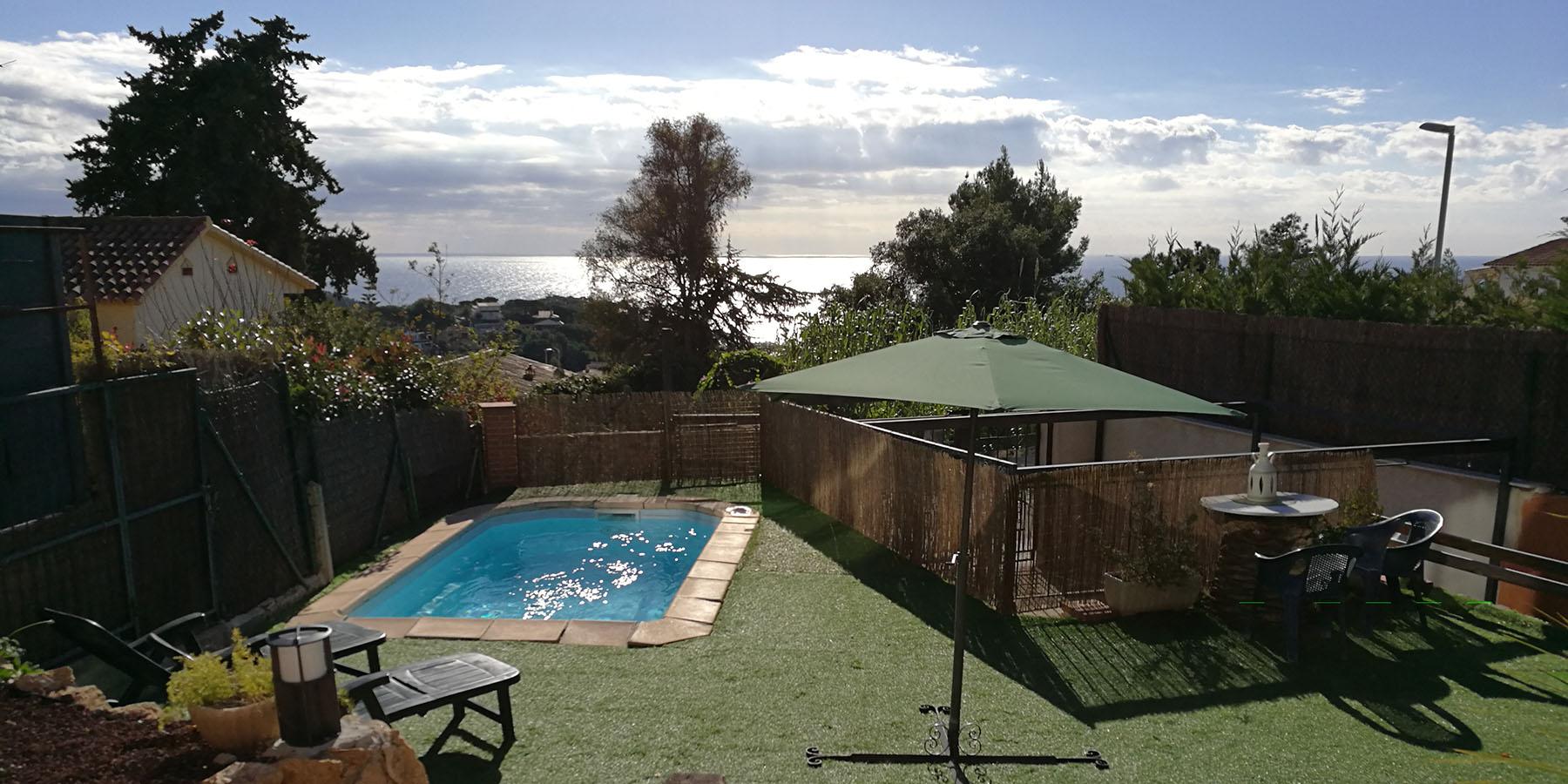 Casa amb piscina, jardí i barbacoa